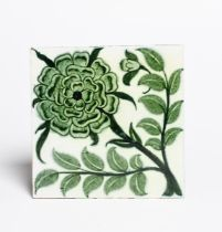 A William De Morgan Sand's End Pottery Four Inch Rose (variant) tile, painted with a rose in green