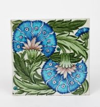 A William De Morgan Late Fulham Period Double Carnation large tile, painted with two large