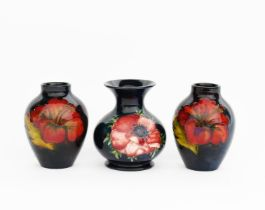 'Flambe Hibiscus' a pair of Moorcroft Pottery vases designed by Walter Moorcroft, swollen,