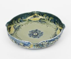 A James Macintyre & Co Florian Ware dish designed by William Moorcroft, footed, circular form with