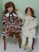 2 German bisque head dolls with jointed composition bodies; taller doll height 78cm has closing