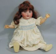 A Heubach of Köppelsdorf bisque head doll, impressed ' Koppelsdorf DRGM Thuringia', with chubby face
