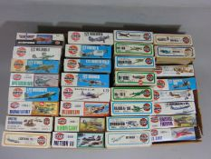 32 Airfix model aircraft kits, all un-started, 11 of which have original cellophane seal