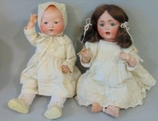 2 German bisque head baby dolls, both with composition bodies and bent limbs; a 1920's Dream Baby by