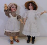 2 early 20th century bisque socket head dolls, both approx 55 cm tall with jointed composition body,