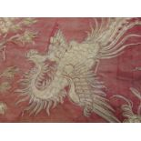 Antique Chinese textile panel comprised of several embroidered silk fabric sections stitched