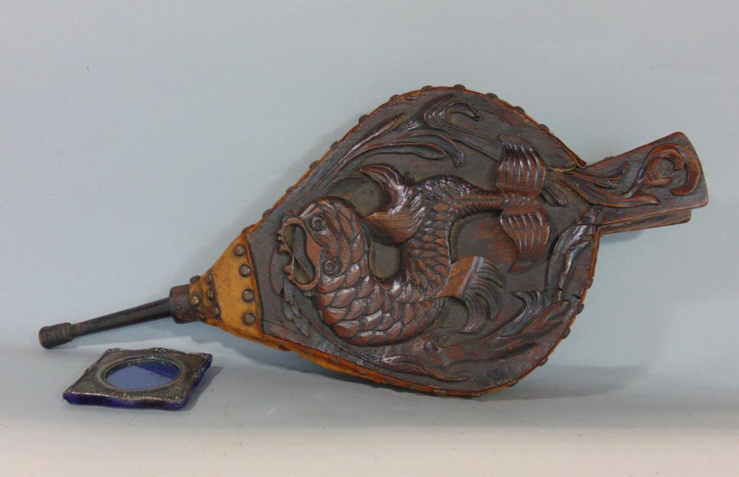 Pair of antique oak fire bellows carved with a coiled fish amidst reeds, with studded leather