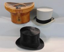 Leather hat box containing brushed silk black top hat by Henry Heath (internal circumference 57cm)