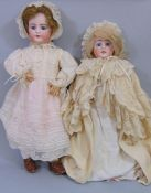 2 circa 1920's bisque head dolls both with jointed composition bodies, fixed blue eyes,open mouth