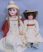 2 large well dressed bisque head dolls with jointed composition bodies, pierced ears, open mouth