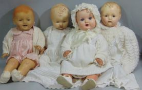 Four 20th century baby dolls including a 63cm tall doll marked Effanbee with composition head and