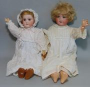 2 German bisque head dolls both with blue sleeping eyes, open mouth with teeth, short fair hair,