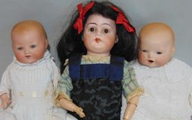 3 small German dolls including a shoulder head doll with fixed brown eyes, wooden arms and cloth