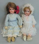 2 German bisque socket head dolls with jointed composition bodies, both with sleeping blue eyes