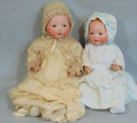 2 Armand Marseille Dream Babies both with bisque socket heads on composition bodies with bent limbs,