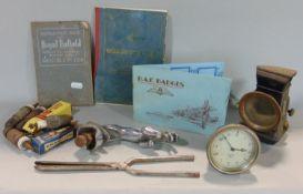 A mixed gent's lot comprising various old spark plugs, a car clock, a lantern, a Jaguar mascot, a
