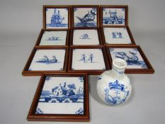 A collection of ten various 19th century delft blue and white tiles with painted decoration