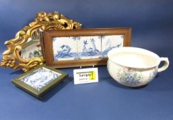 A set of three early 19th century Delft type blue and white tiles with painted fish and sea