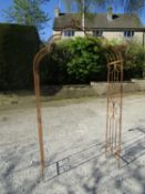 An arched metal arbour/rose arch, 132 cm wide x 230cm high approx