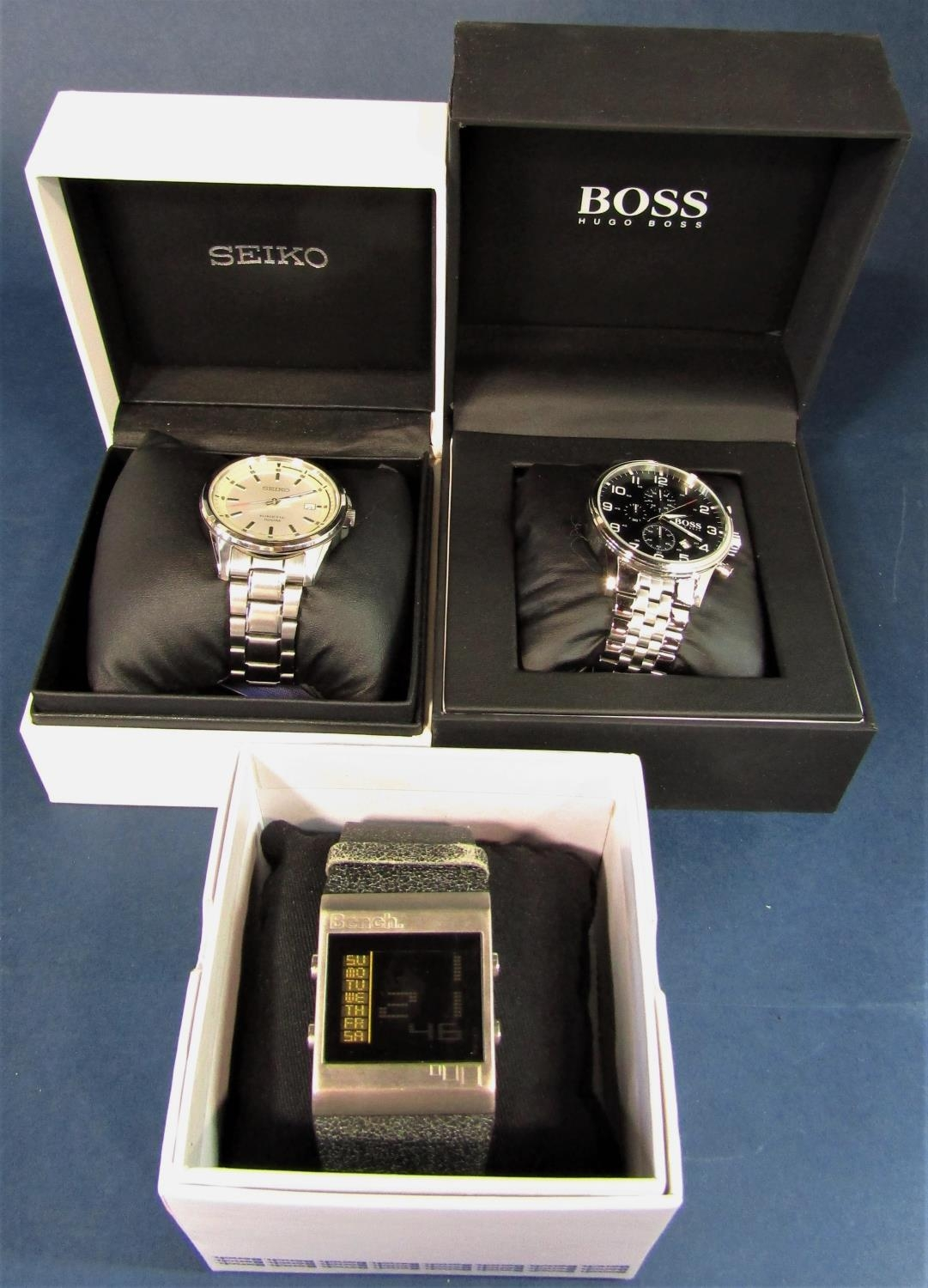 Three boxed fashion watches to include a Seiko kinetic 100m, with box and guarantee certificate,