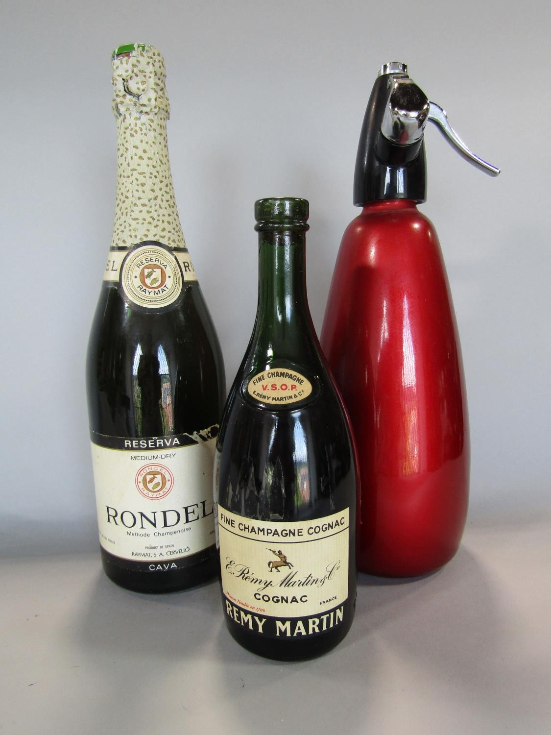 Bottles of Remy Martin Cognac, Rondel Cava and a soda siphon (3)