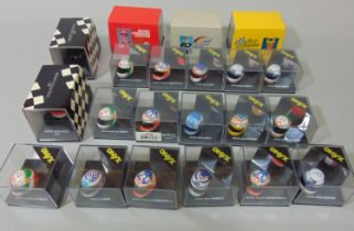Collection of 16 boxed 1:12 scale F1 helmets by Onyx, all die-cast with plastic parts together