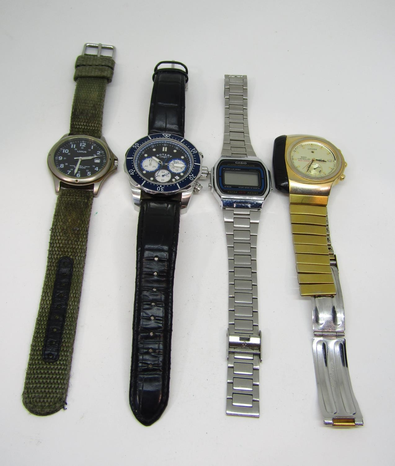 Four good vintage gents wristwatches to include a Rotary quartz divers watch with black dial and