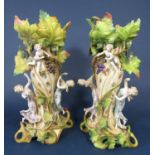 A pair of large late 19th century continental vases with applied dancing classical figures and