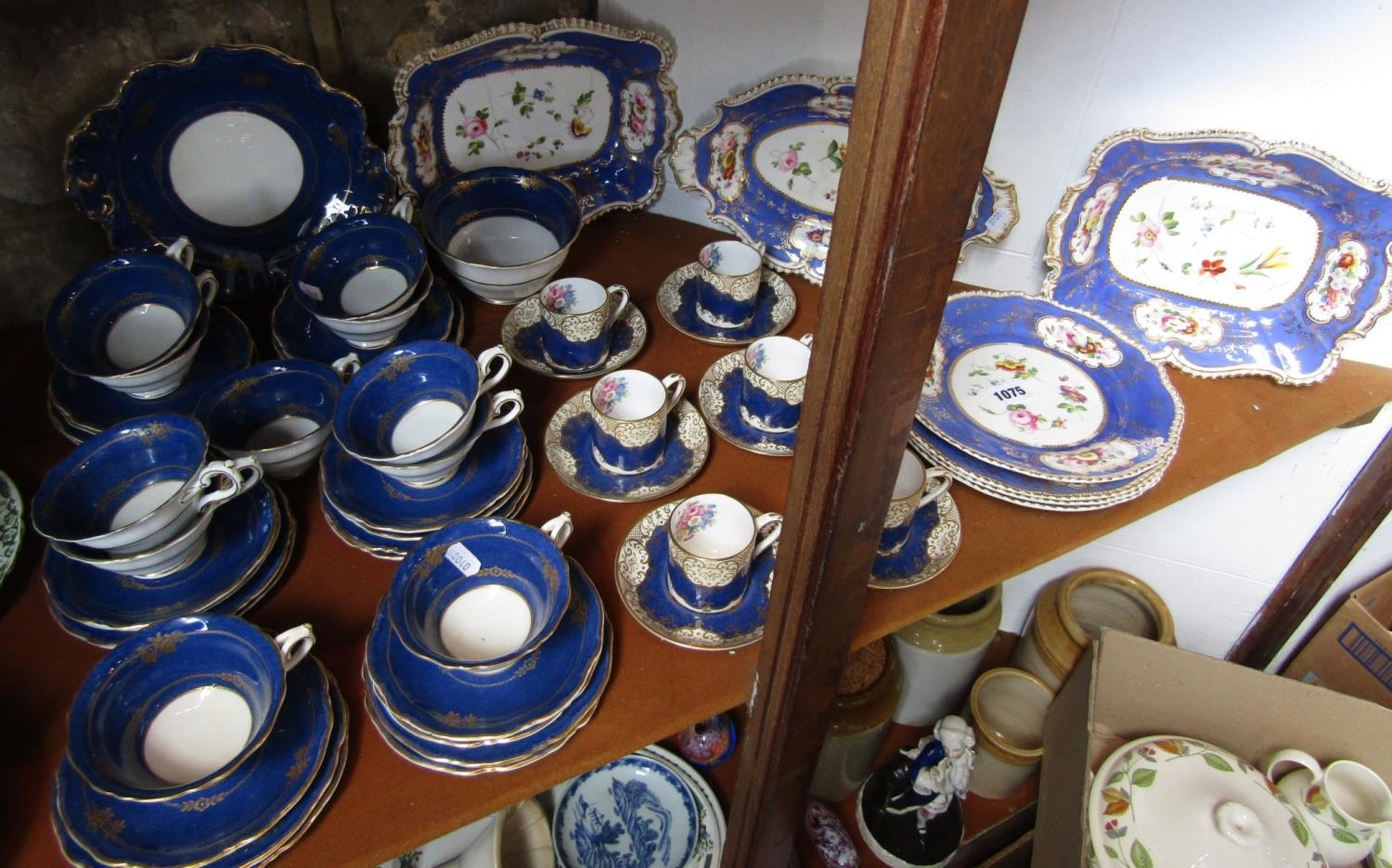 A collection of 19th century dessert wares with reserved floral panels on a blue ground, - Bild 2 aus 2
