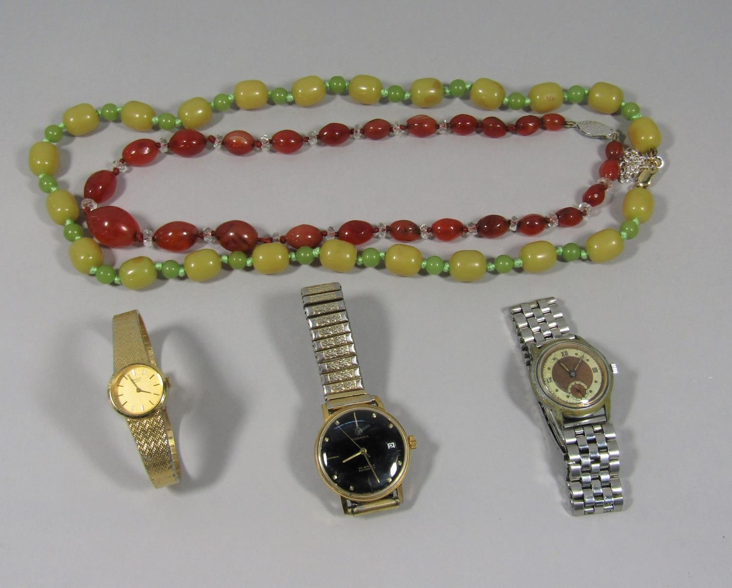 Phenolic green bead necklace with later 9ct clasp and a further graduated carnelian bead necklace