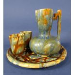 An unusual Swedish water set by Andersson & Johansson for Hoganas pottery, comprising a ewer with