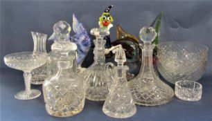 A collection of glassware to include decanters, jugs, bowls, a Murano glass clown, fish and