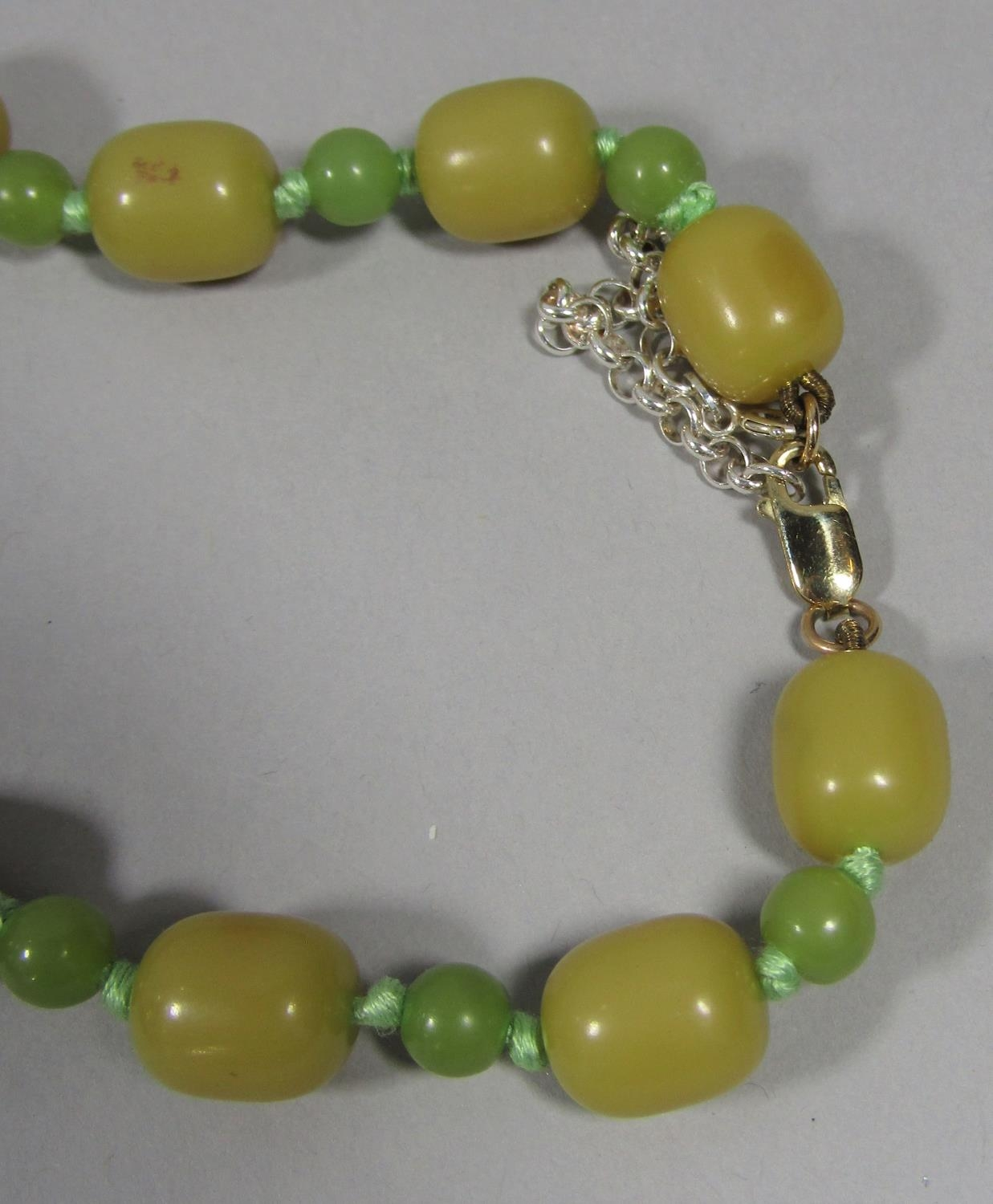 Phenolic green bead necklace with later 9ct clasp and a further graduated carnelian bead necklace - Image 3 of 3