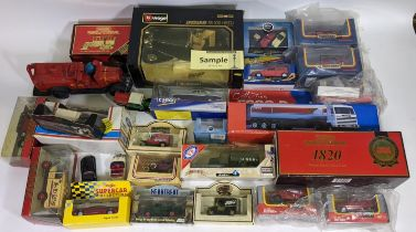 Large collection of boxed model vehicles including Burago Jaguar SS100, 17 Maisto Supercars, Corgi