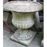 A reclaimed garden urn with flared egg and dart rim, lobed body and square cut base, 52cm diameter x