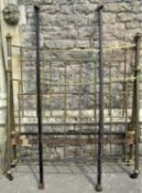 A Victorian brass and iron bedstead with square bars and turned rails, 140cm wide (af)