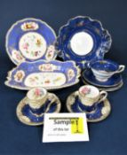 A collection of 19th century dessert wares with reserved floral panels on a blue ground,
