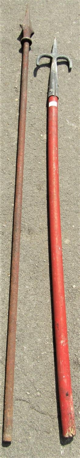 A reclaimed heavy iron pole with arrow head finial, 188cm high, together with a wooden staff with