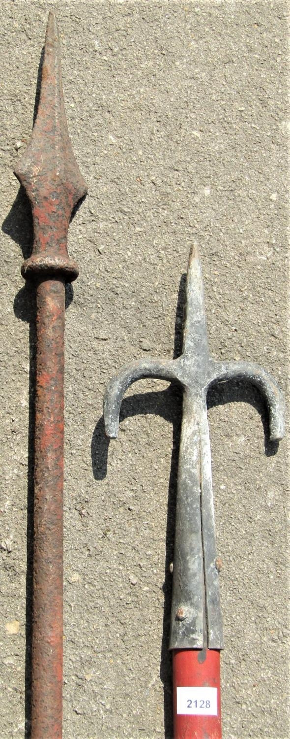 A reclaimed heavy iron pole with arrow head finial, 188cm high, together with a wooden staff with - Image 2 of 2