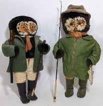 A pair of character soft toy standing figures with feathery owl faces, both dressed for country