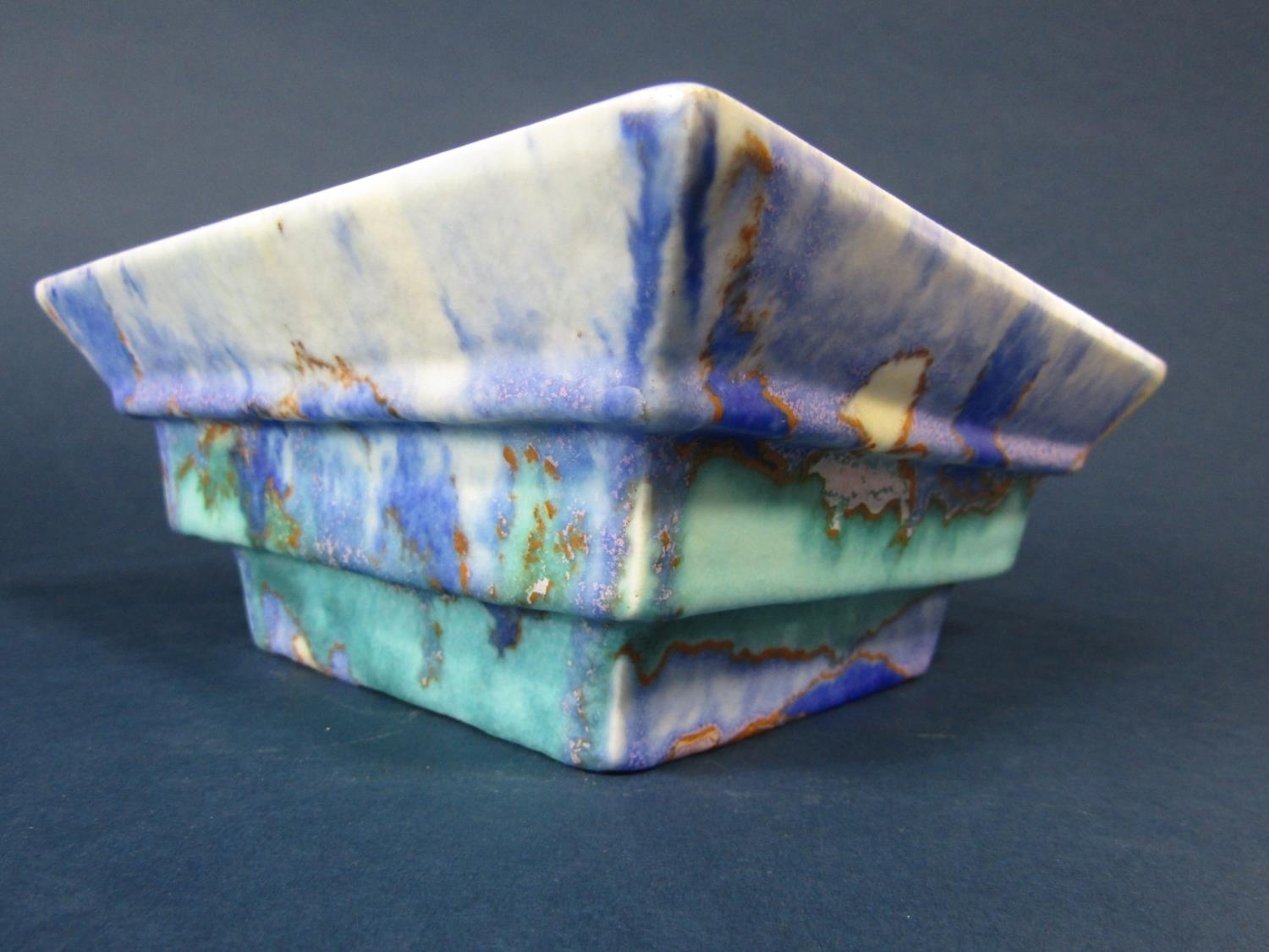 A Clarice Cliff Bizarre bowl of four sided stepped form with mottled turquoise blue and gold