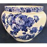 A large Doulton Burslem Gloire-de-Dijon patterned jardinière with blue printed floral decoration,