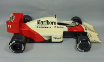 Large static kerbside model of McLaren Honda Formula 1 Racing Car MP4/4 1988, likely to have been