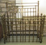 A good quality Victorian brass and iron double bedstead, the tubular framework withy cube