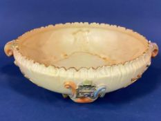 A Royal Worcester two handled bowl with applied stylised leaf detail on a blush ivory ground, with