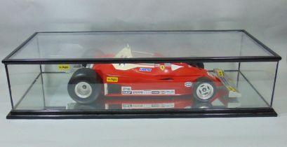 Static kerbside 1:6 scale model of Formula 1 Ferrari 312 T2 racing car by Toschi/ Polistil, in