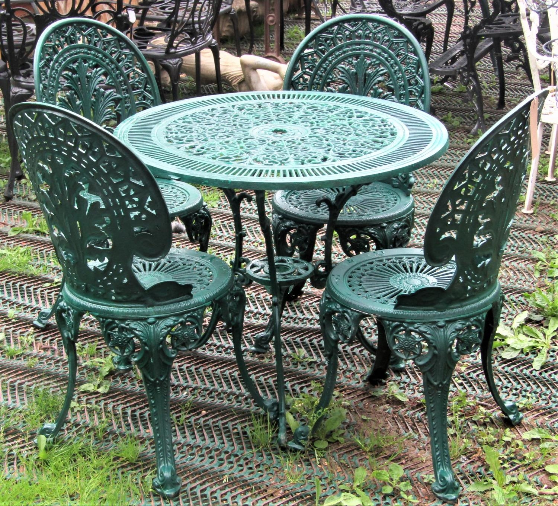 Green painted cast aluminium garden terrace table of circular form with decorative pierced tudor