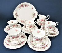 A collection of Royal Albert Lavender Rose pattern tea wares comprising milk jug, sugar bowl, cake