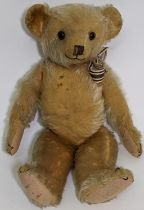 1930's teddy bear possibly by Merrythought with golden mohair, slight humped back, glass eyes,
