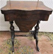 A mid Victorian period walnut and figured walnut ladies sewing/games table, the serpentine front
